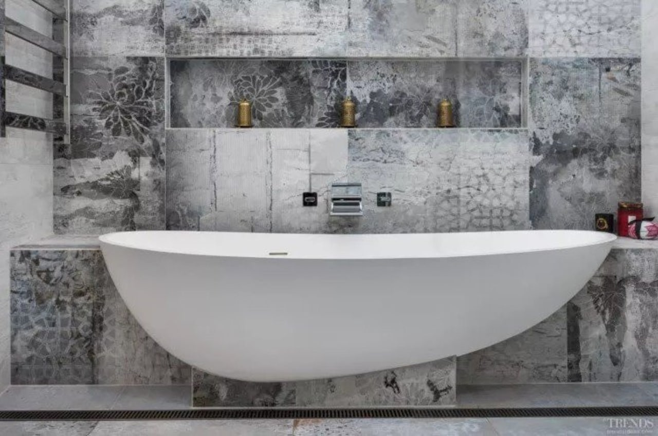 A combined shower and tub area saves space bathtub, floor, plumbing fixture, tap, tile, gray