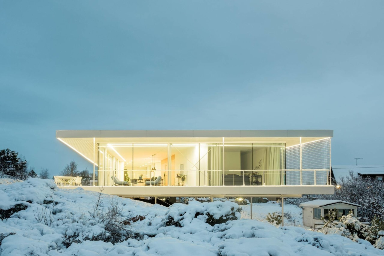 The powerful light strip lights up the living architecture, cottage, home, house, property, real estate, sky, snow, winter, teal