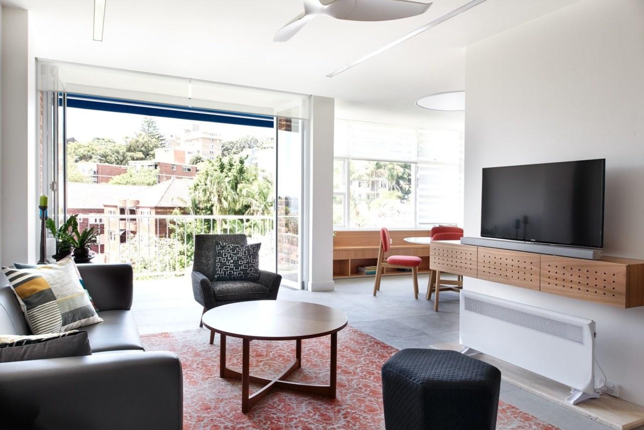 A shelf for the TV means more floor interior design, living room, real estate, room, white