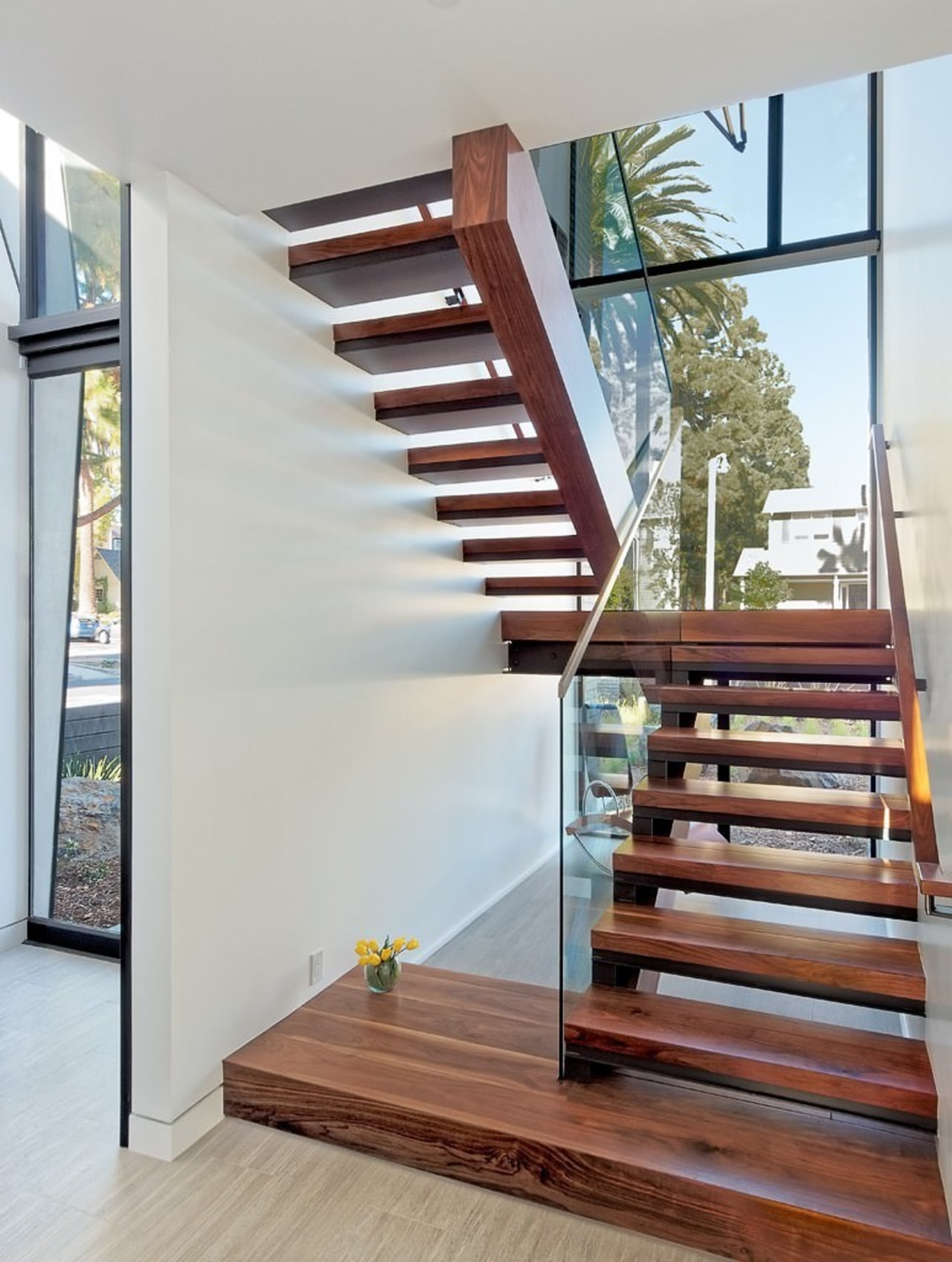 Using wood here helps to create an element baluster, floor, handrail, hardwood, interior design, stairs, wood, gray