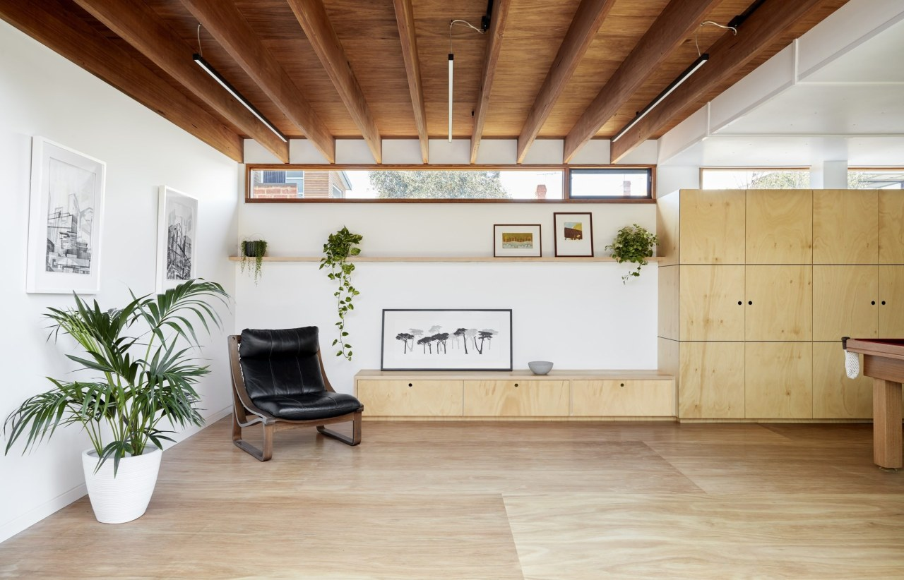 Exposed wood beams run across the ceiling, meeting architecture, ceiling, daylighting, floor, flooring, hardwood, house, interior design, loft, property, real estate, wood, wood flooring, gray, brown