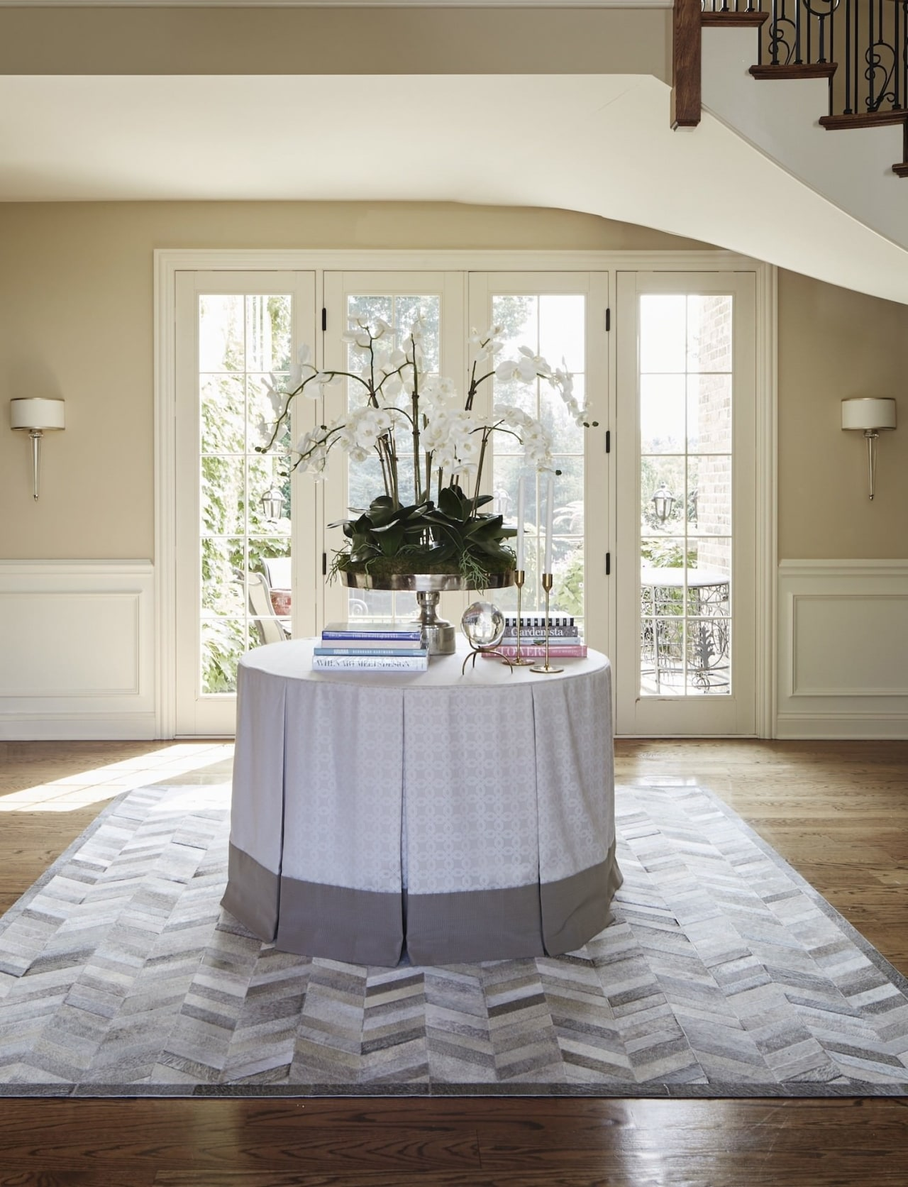 It's important to lay rugs flat , with chair, dining room, floor, flooring, furniture, hardwood, home, house, interior design, living room, room, table, window, wood, wood flooring, gray