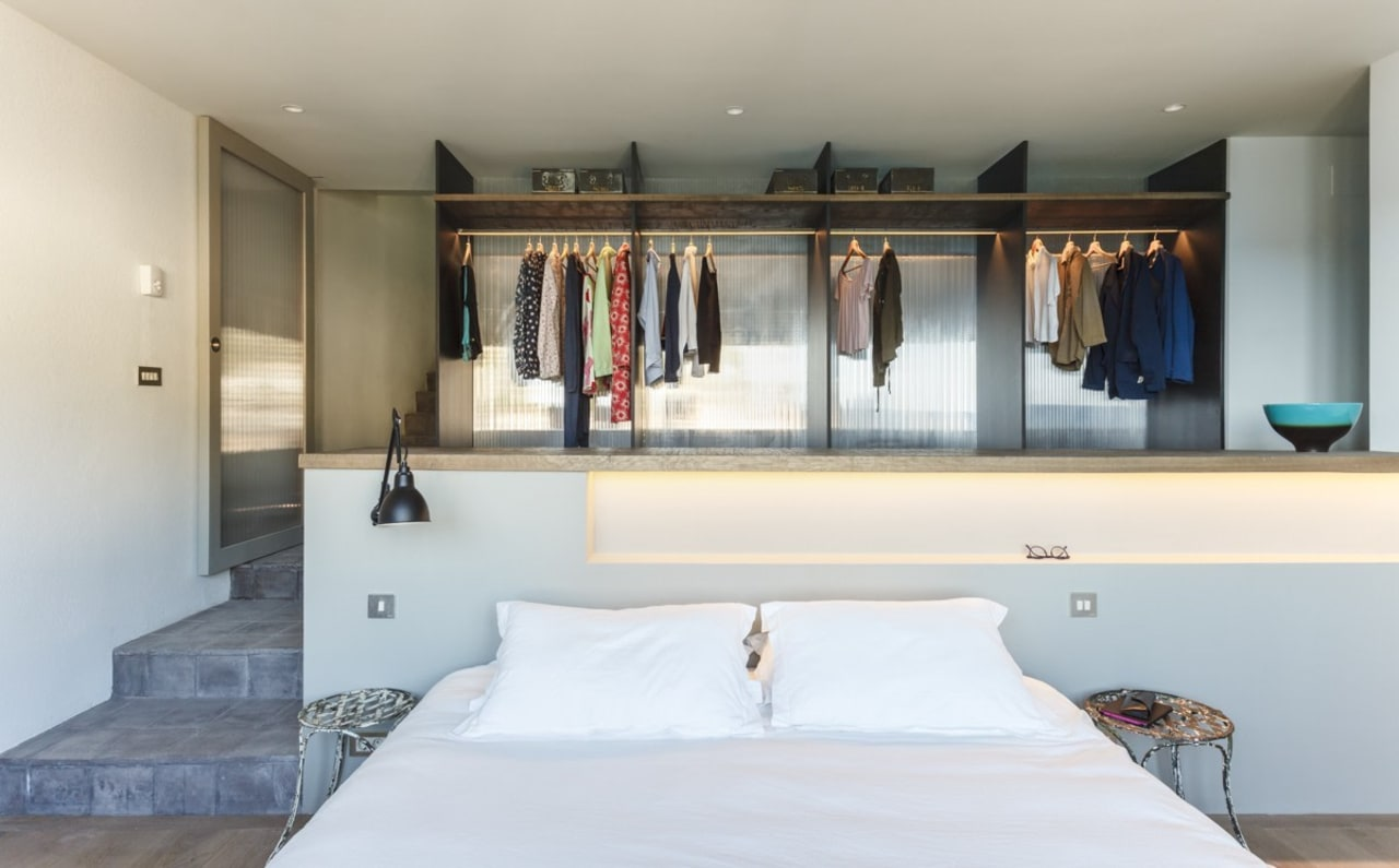 The open wardrobe creates an interesting focal point architecture, bedroom, furniture, home, house, interior design, property, real estate, room, wall, gray, white