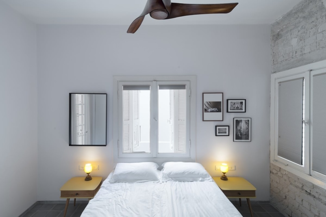 The brick wall draws the eye – but bedroom, ceiling, daylighting, home, house, interior design, property, real estate, room, window, gray