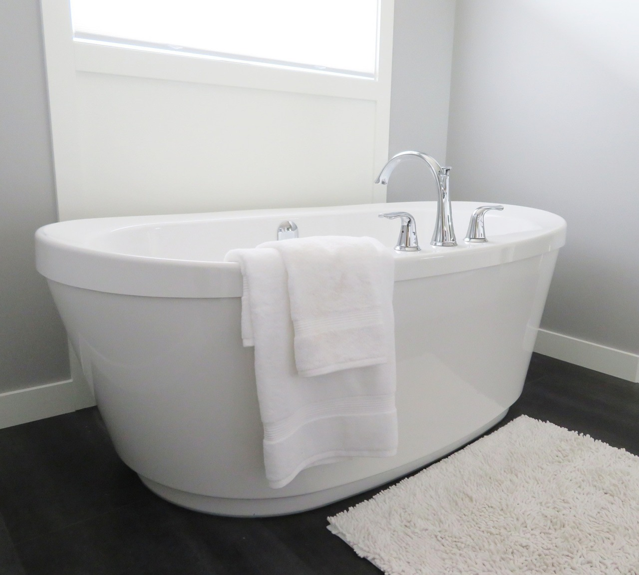 A new bathtub could completely change the look angle, bathroom, bathroom accessory, bathroom cabinet, bathroom sink, bathtub, bidet, plumbing fixture, product, product design, tap, toilet seat, gray, white