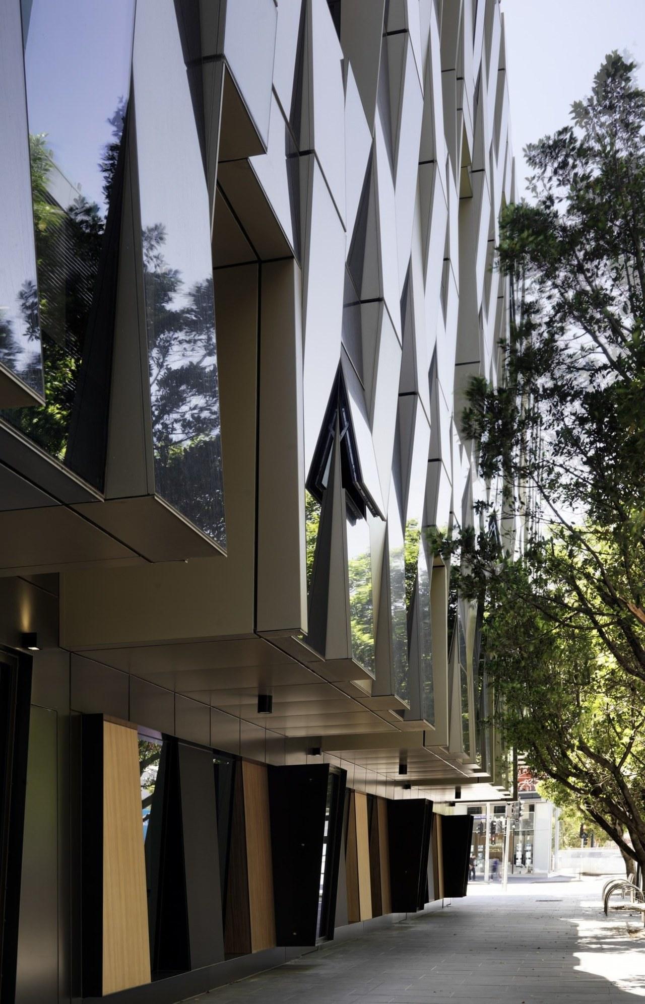Promenade Aqui by Woods Bagot architecture, building, facade, house, black, gray