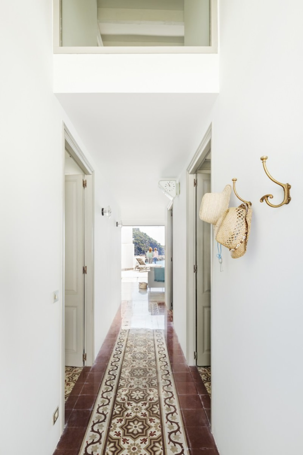The hallway is largely unchanged, which certainly seems ceiling, floor, home, house, interior design, property, real estate, white