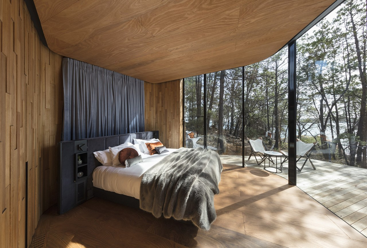 The curving bedroom pod provides wide views of