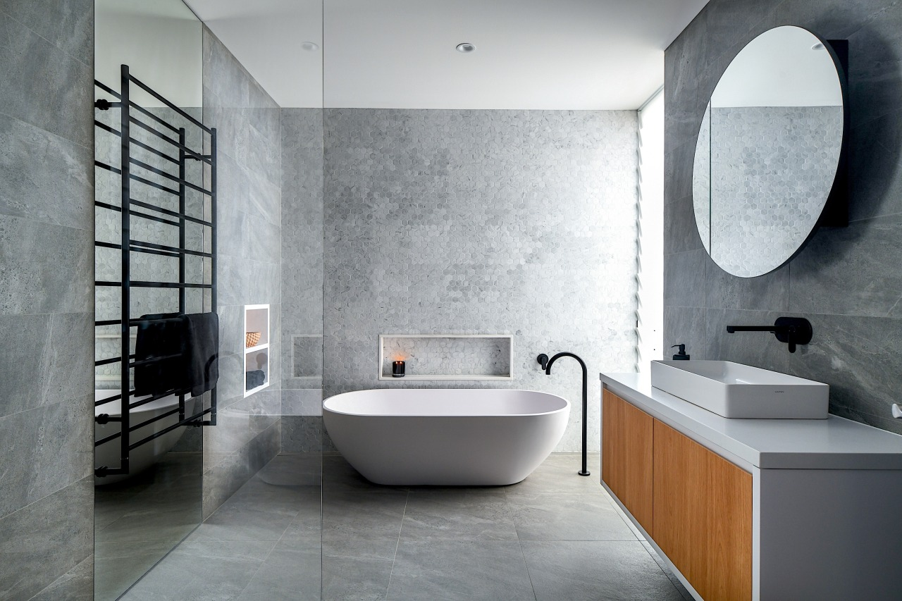 Hexagon Carrara marble tiles, a freestanding tub, a architecture, bathroom, bathtub, bidet, building, ceramic, floor, flooring, house, interior design, material property, plumbing fixture, property, room, tap, tile, wall, gray