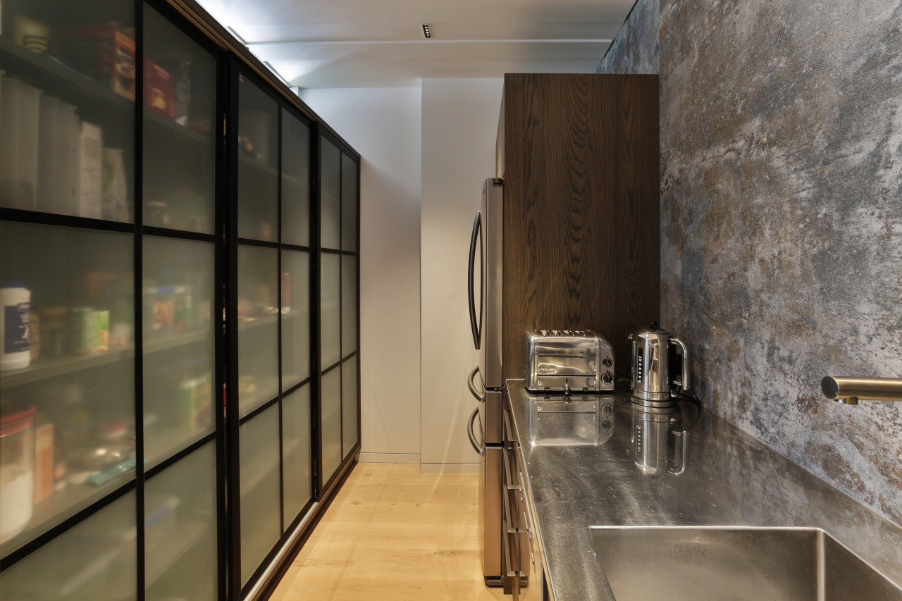The scullery features the same modern concrete-look splashback