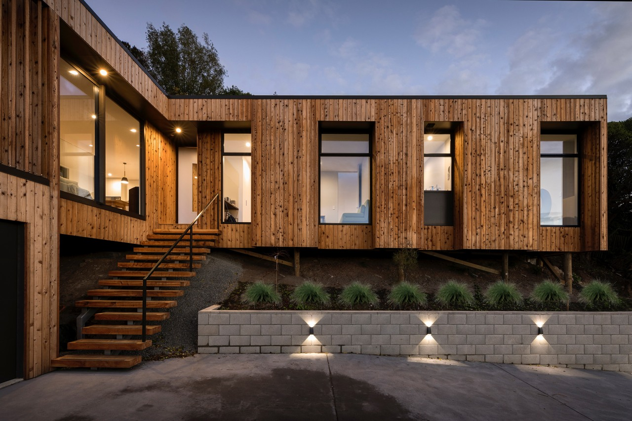 The L-shaped floorplan was a natural response to architecture, building, elevation, estate, facade, home, house, property, real estate, residential area, siding, window, black, brown