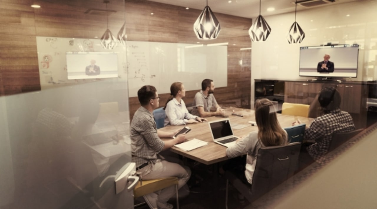 Start Up business people group at video-conference. furniture, interior design, office, orange, brown
