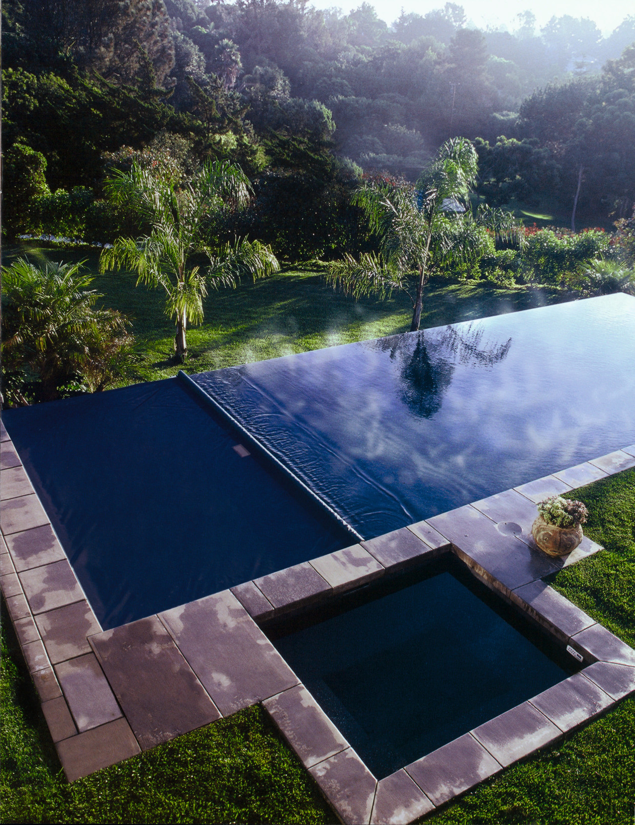 View of swimming pool and automatic pool cover backyard, estate, grass, landscape, leisure, nature, plant, property, real estate, reflection, reservoir, sky, swimming pool, tree, water, water feature, water resources, blue