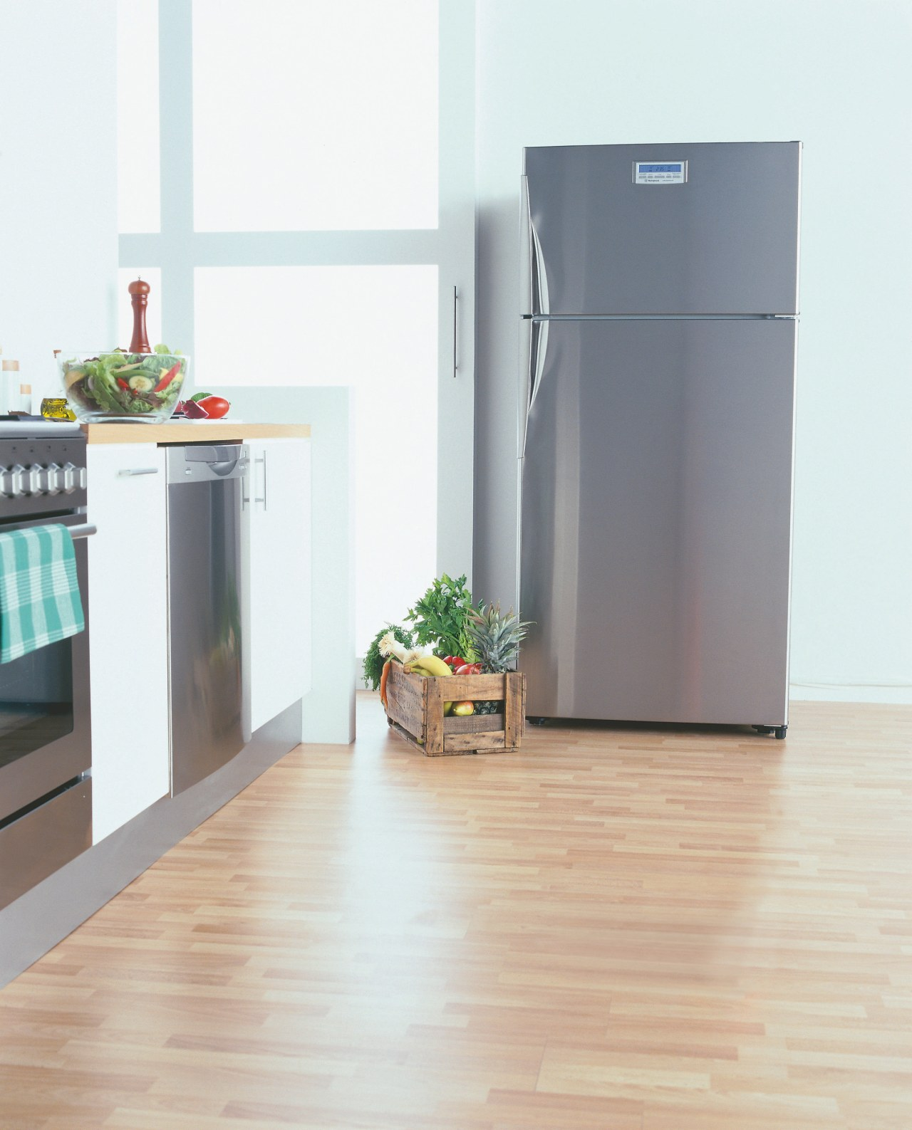 Stylish Refrigerator in kitchen setting. floor, flooring, hardwood, home appliance, kitchen appliance, laminate flooring, major appliance, product, refrigerator, white, gray