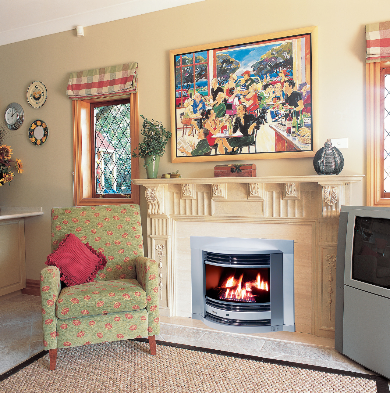 Lounge room with gas fireplace in cream surround, fireplace, furniture, hearth, home, home appliance, interior design, living room, room, wall, wood burning stove, white, orange