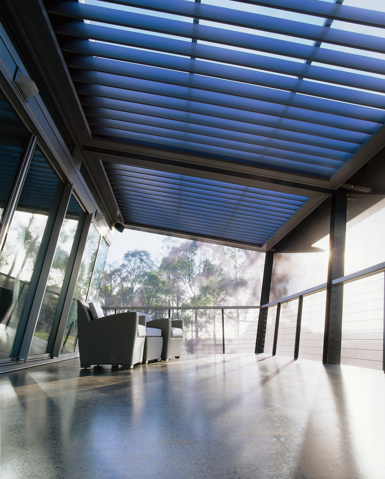 View of a netted urban balcony features polished architecture, ceiling, daylighting, roof, structure, white, black