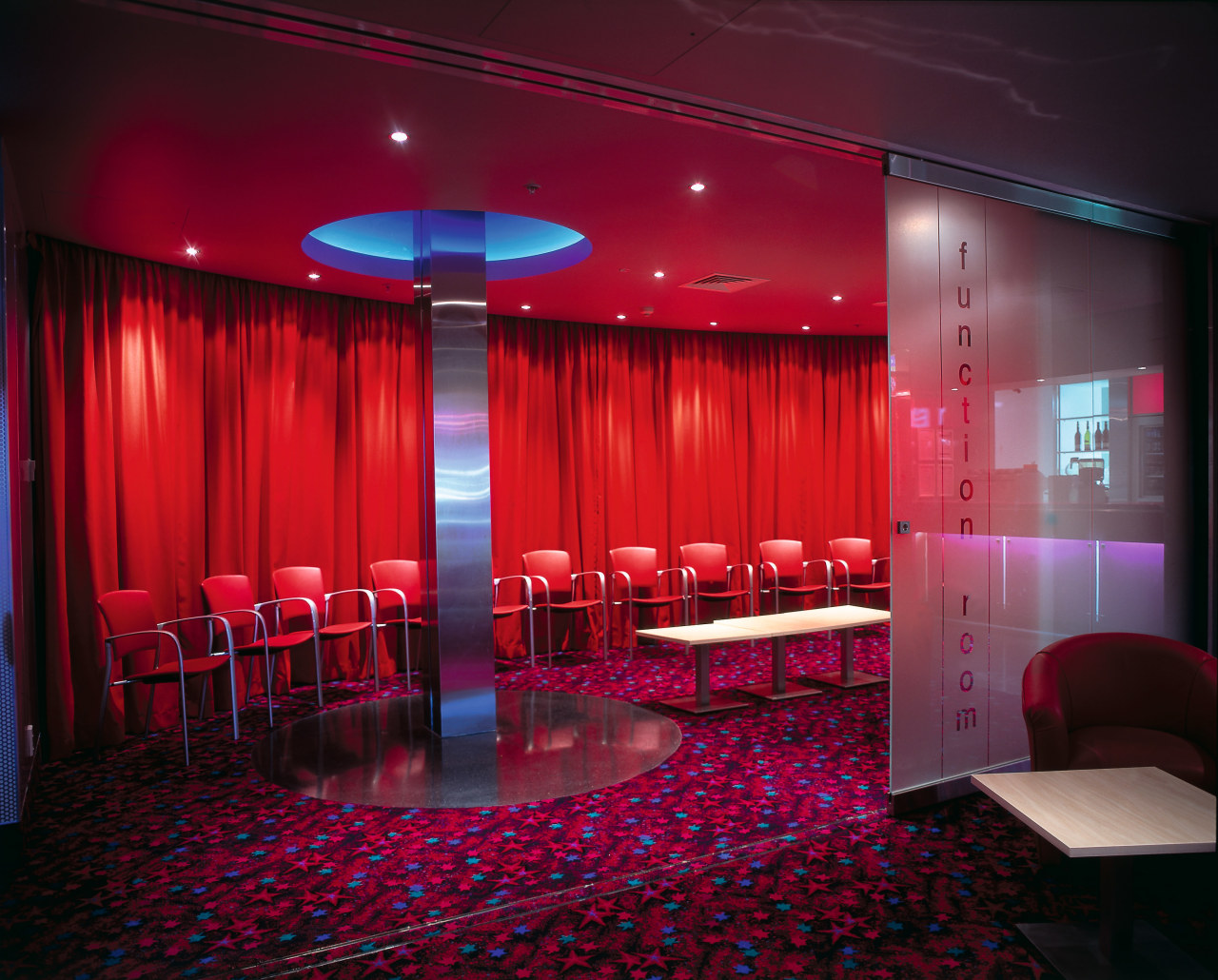 Westfield St Lukes Village Skycity cinema. Function room auditorium, ceiling, entertainment, function hall, interior design, light, lighting, red, stage, table, red