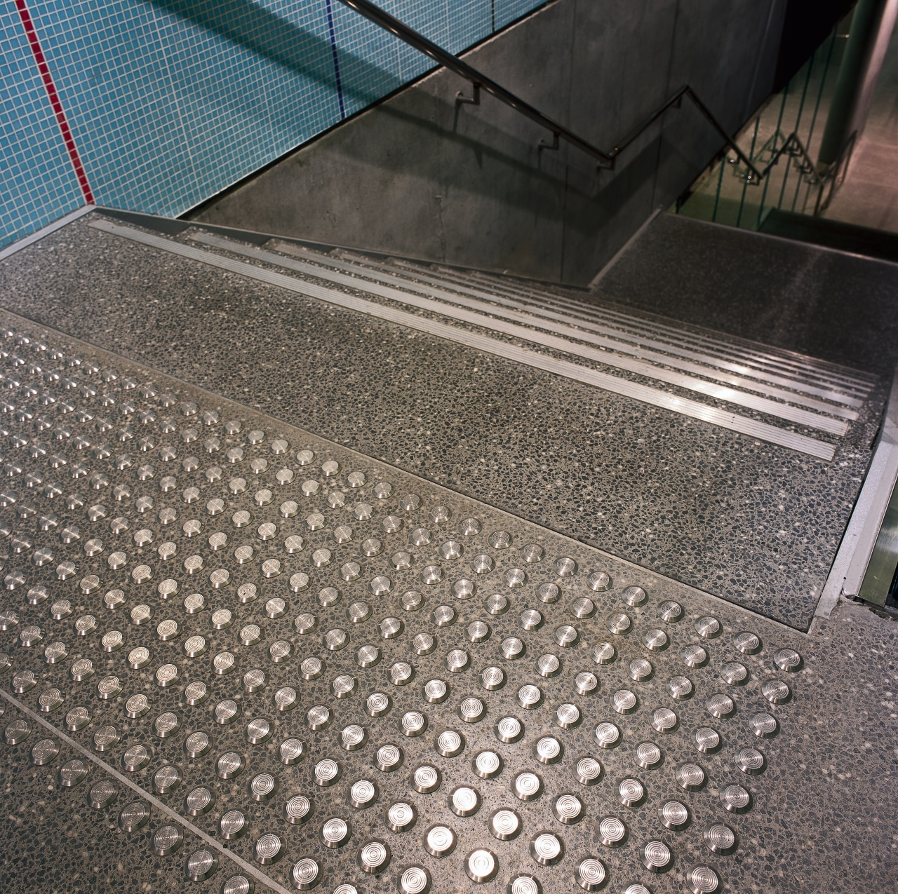 Auckland's Britomart Transport Centre. The stainless steel tactile architecture, asphalt, daylighting, floor, flooring, line, mesh, metal, road surface, steel, gray, black