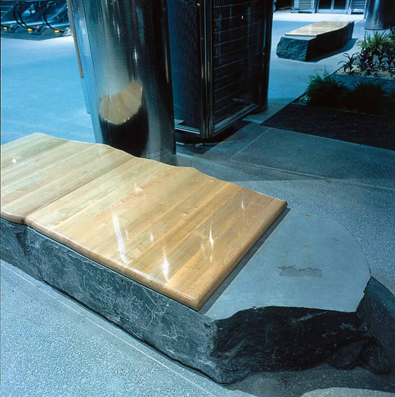 Auckland's Britomart Transport Centre. This timber seat is floor, water, wood, teal, black