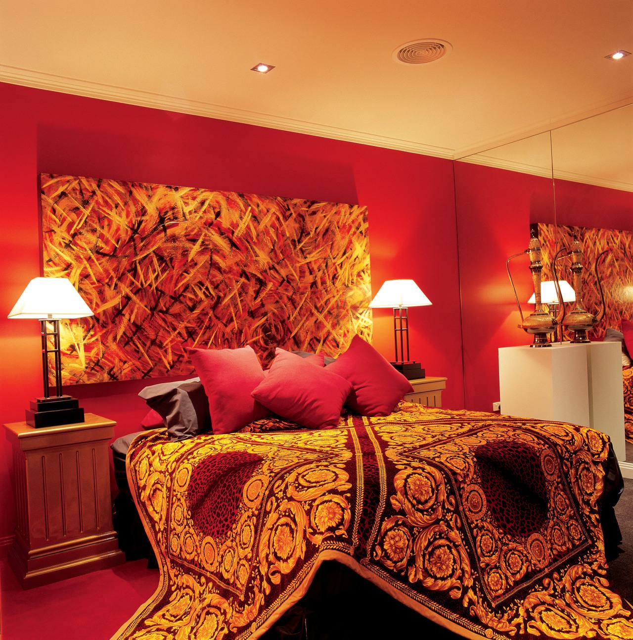 View of this bedroom bed sheet, bedroom, ceiling, interior design, modern art, orange, room, suite, wall, red, orange