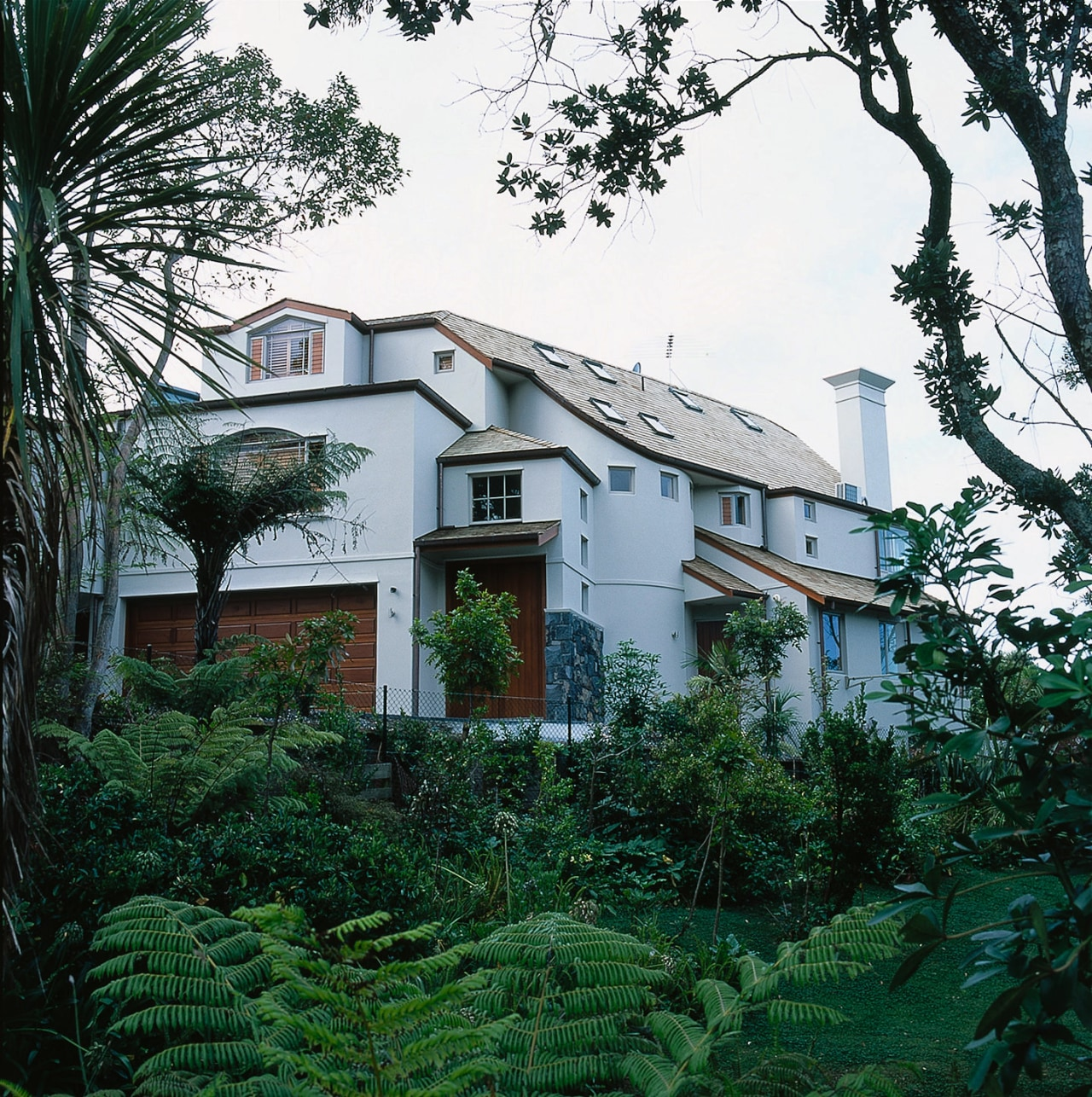 View of this large home architecture, building, cottage, estate, facade, home, house, mansion, neighbourhood, plant, property, real estate, residential area, tree, villa, window, white, green