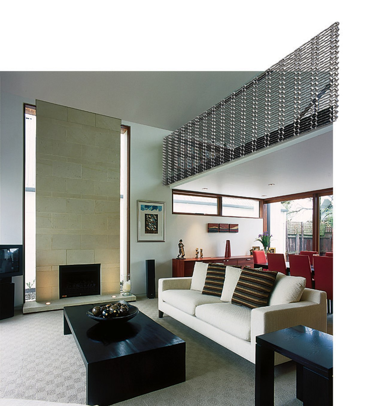 A seating area featuring designer mesh. The area architecture, ceiling, daylighting, furniture, interior design, living room, table, wall, white, gray