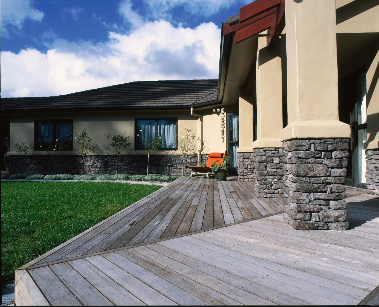House with cream cladding and dark grey schist deck, home, house, outdoor structure, property, real estate, roof, walkway, window, gray, black