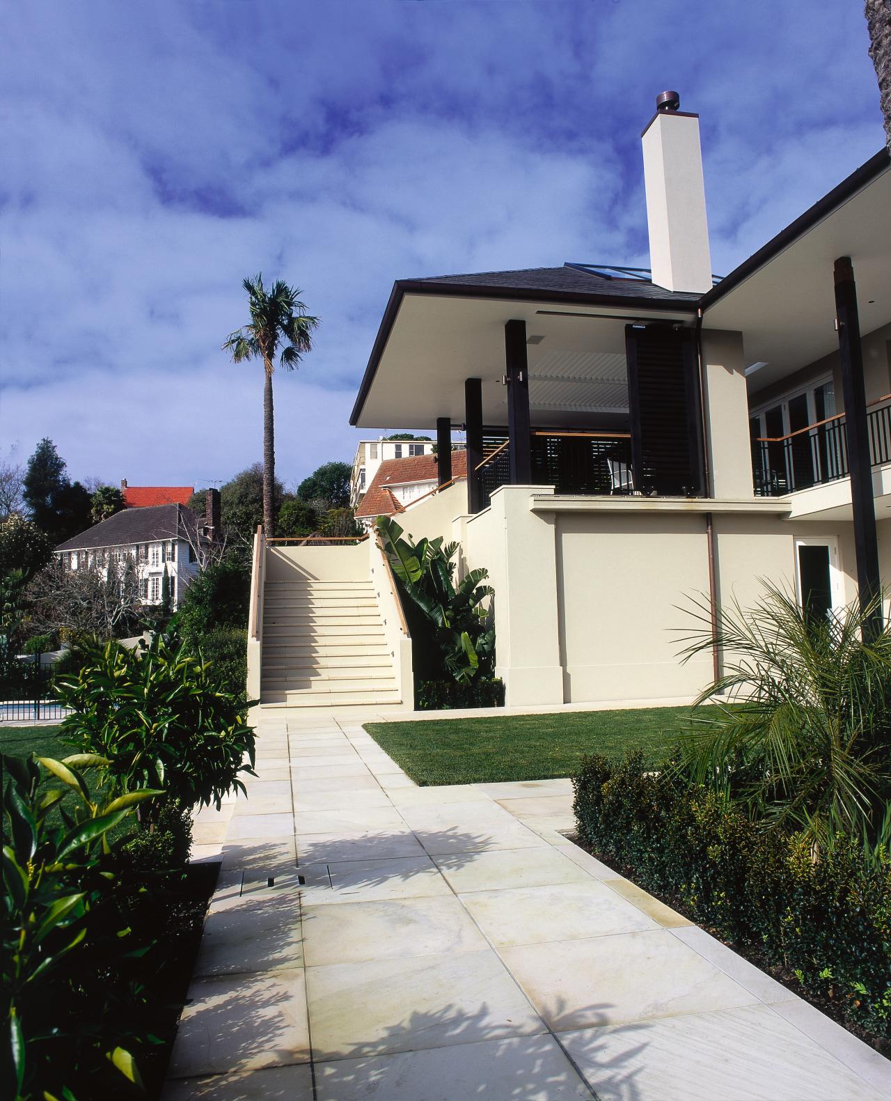 Large cream sandstone tiles surround a front garden architecture, building, cottage, estate, facade, home, house, property, real estate, residential area, sky, villa, blue