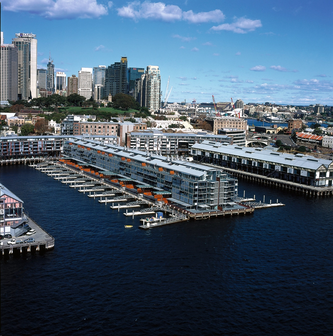 view of the redeveloped pier containg residential apartments aerial photography, bird's eye view, bridge, channel, city, cityscape, fixed link, harbor, marina, metropolis, metropolitan area, motor ship, passenger ship, port, sea, ship, sky, skyline, urban area, water, water transportation, waterway, black, teal