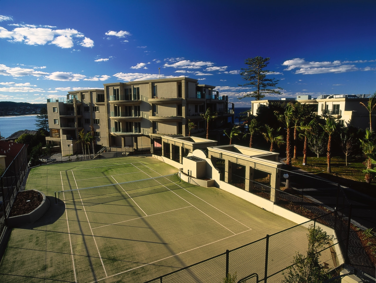 exterior view of tenis courts apartment, architecture, building, campus, city, condominium, corporate headquarters, estate, mixed use, neighbourhood, property, real estate, residential area, roof, sky, structure, suburb, urban area, urban design, brown, black, blue