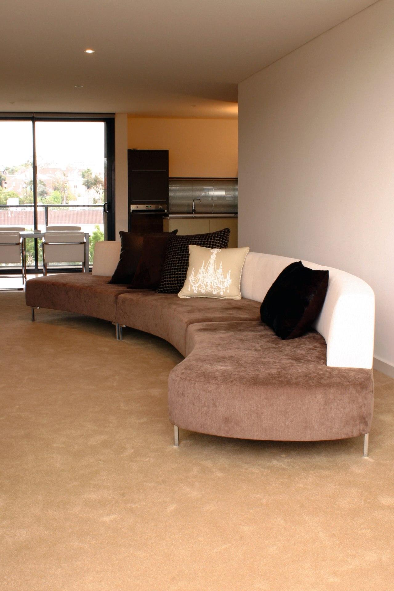 Interior view of sitting area angle, couch, floor, flooring, furniture, hardwood, home, interior design, laminate flooring, living room, room, table, wall, wood, wood flooring, brown, orange