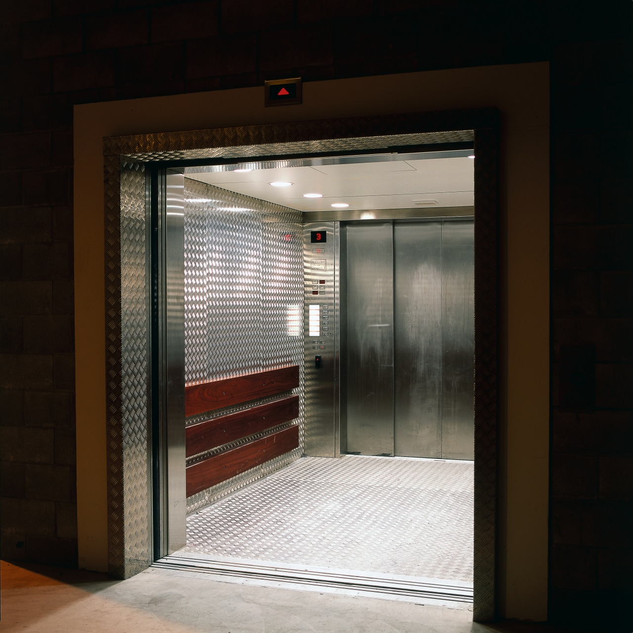 Service lift with heavy gauge aluminium chequer plate door, black