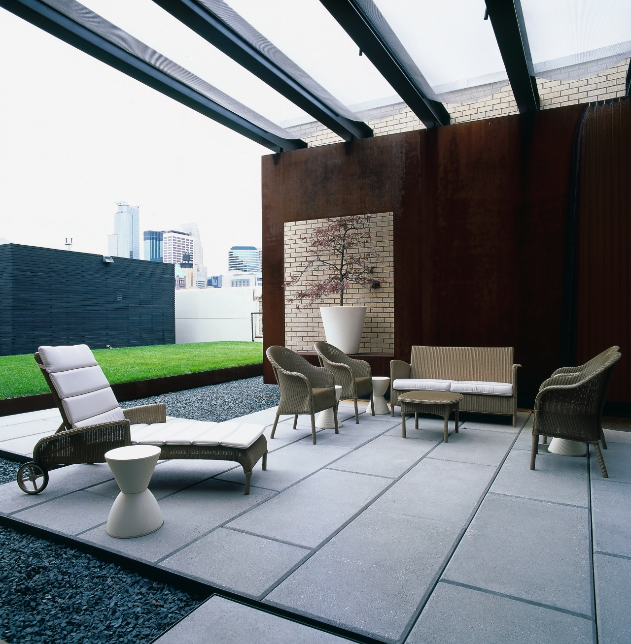 View of the patio area, concrete slab pavers, architecture, chair, daylighting, floor, furniture, house, interior design, living room, real estate, roof, table, black, gray
