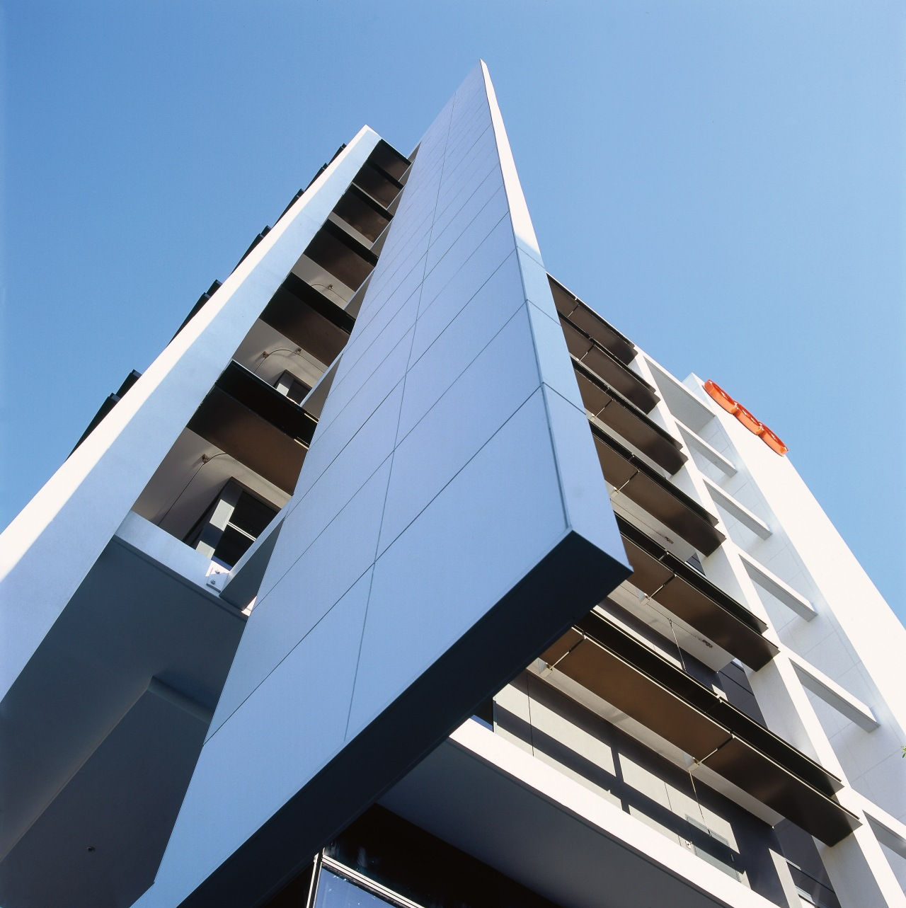 Exterior view of the TNT Australia building from angle, architecture, building, commercial building, condominium, corporate headquarters, daylighting, daytime, facade, line, sky, structure, teal, black