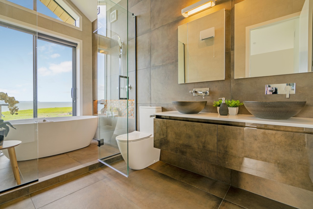 Putting the bath in the shower enclosure enables