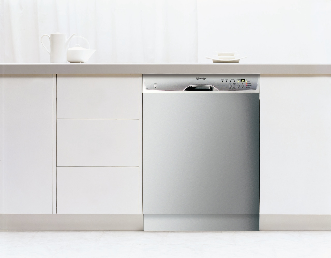 A view of a kitchen with white cabinetry, angle, furniture, home appliance, major appliance, product, product design, sideboard, white