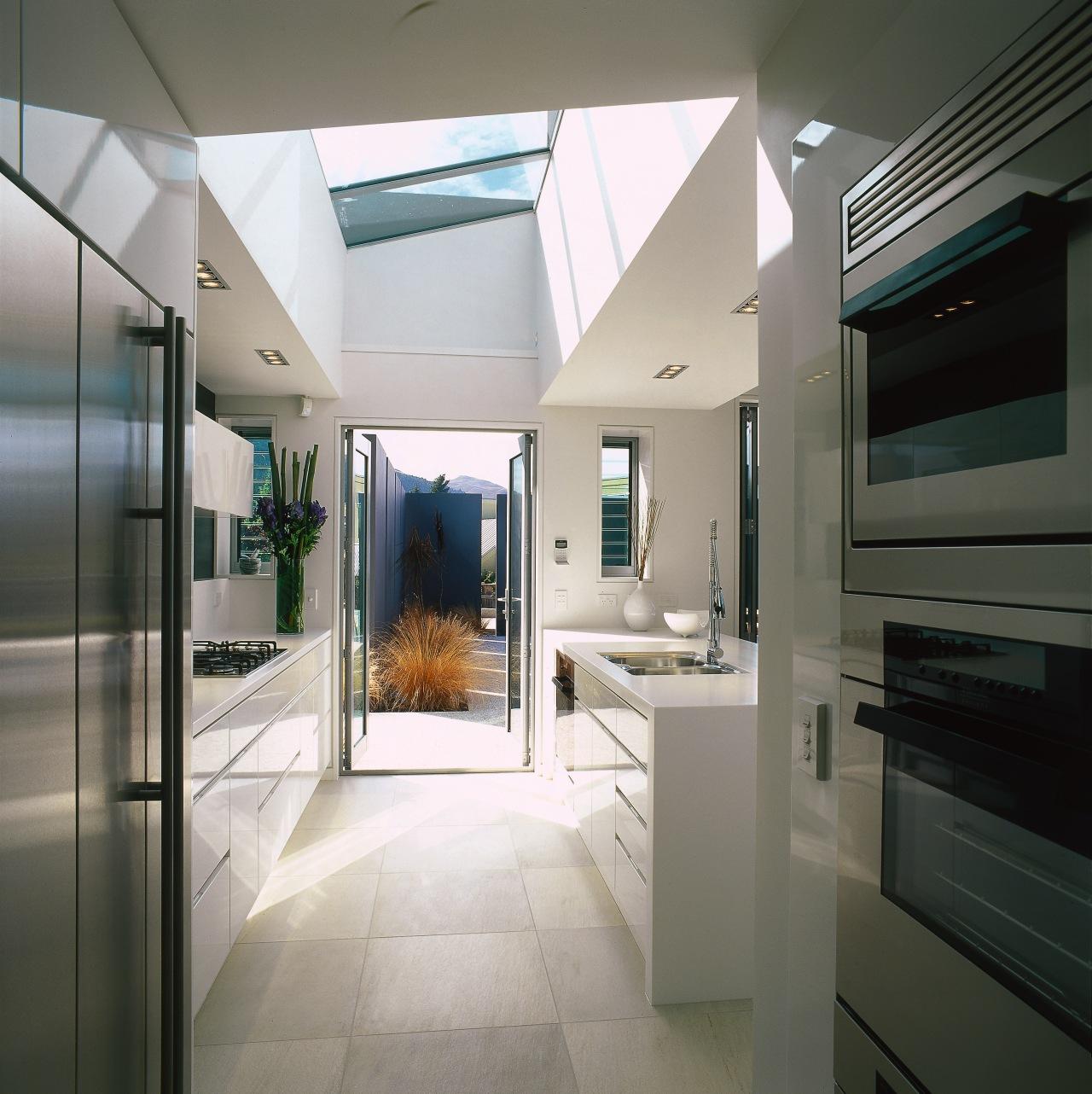 A view of the kitchen area, concrete tiled interior design, gray, black