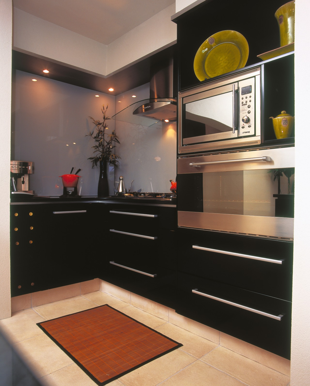 view of the black kitchen cabinetry with amerons cabinetry, countertop, furniture, home appliance, interior design, kitchen, room, black