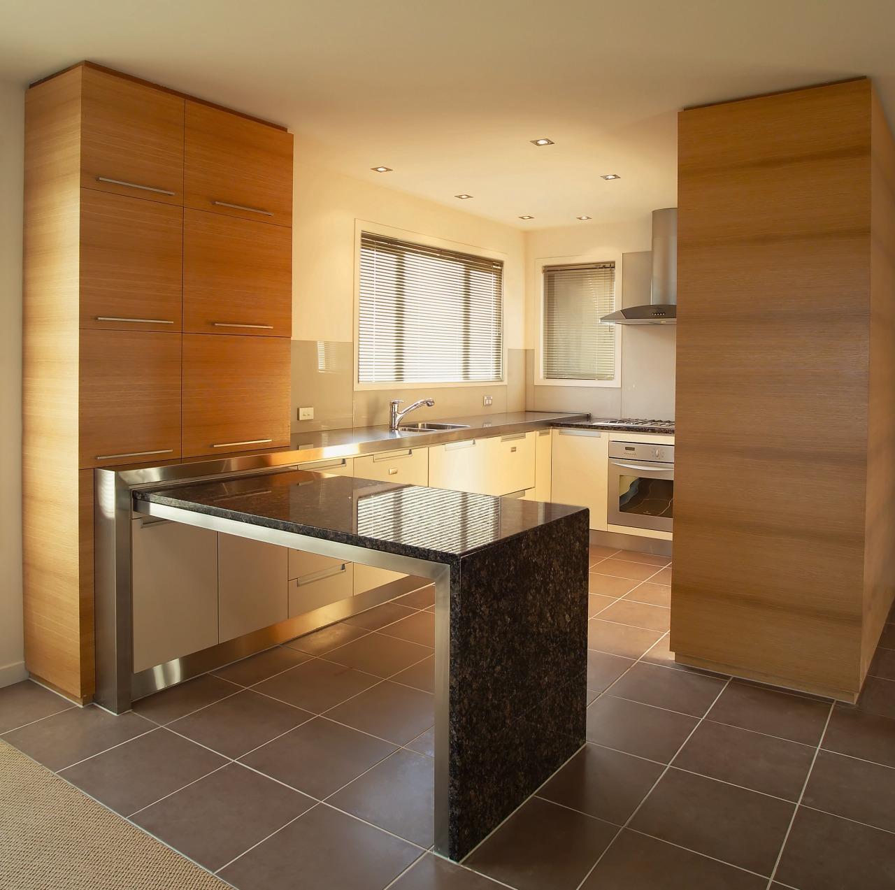 A view of a kitchen area, black tiled cabinetry, countertop, cuisine classique, floor, flooring, interior design, kitchen, real estate, room, brown, orange