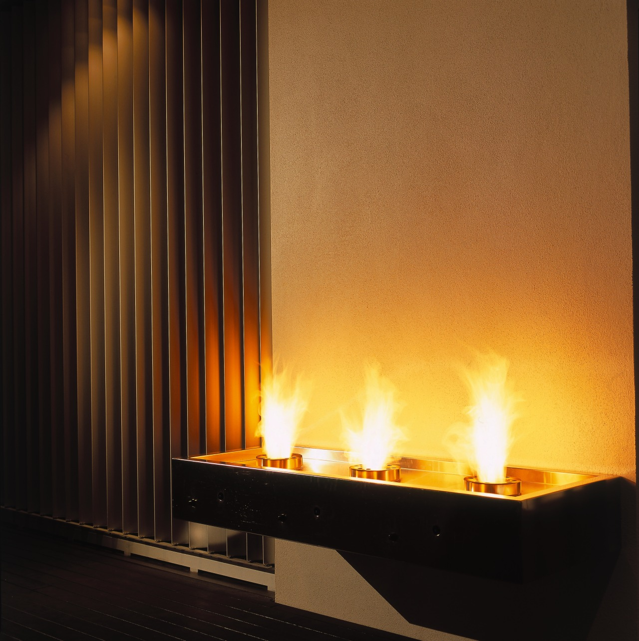 Outdoor gas flares on decking area. fireplace, flame, hearth, heat, interior design, black, brown