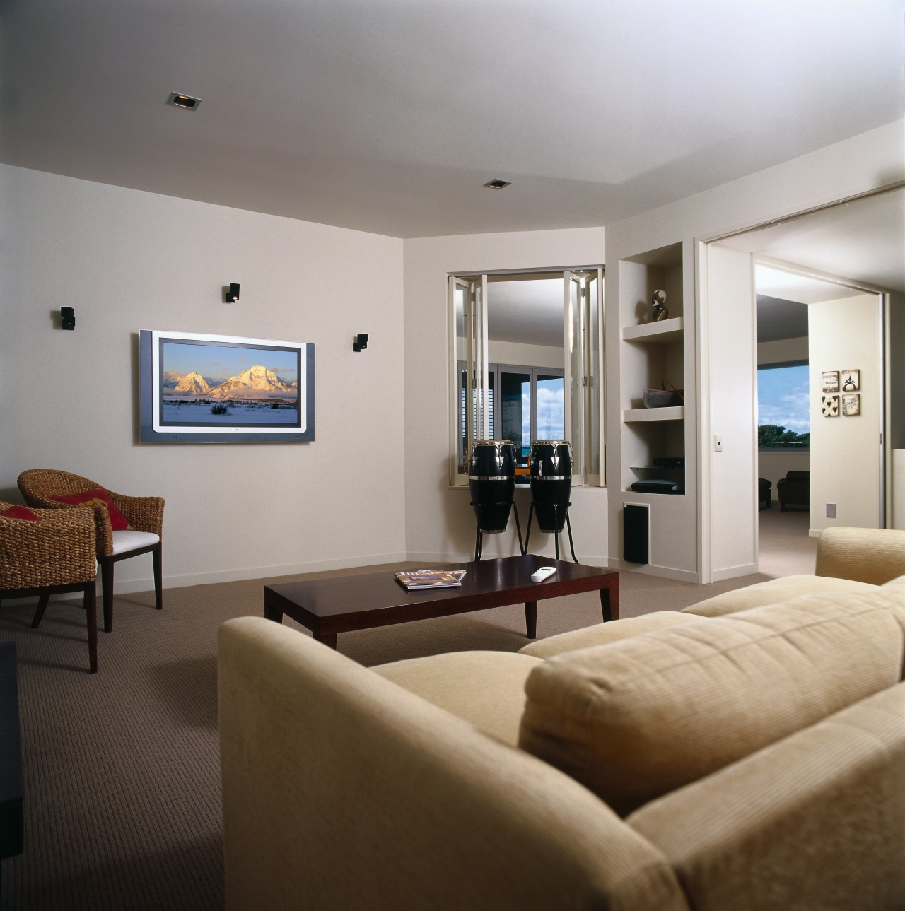 A view of a entertainment centre from Bose. ceiling, interior design, living room, property, real estate, room, suite, gray