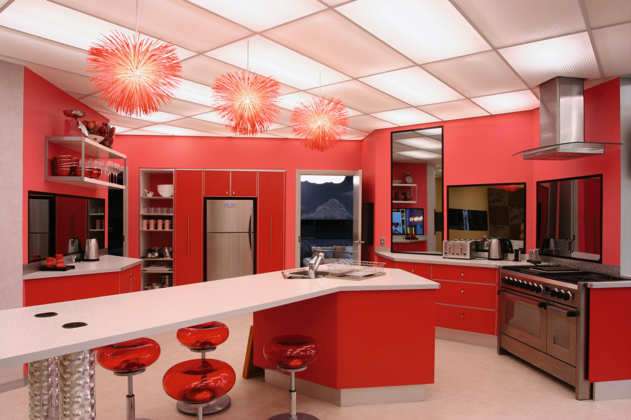 An example of some of the bold colours cabinetry, ceiling, countertop, interior design, kitchen, room, red, gray