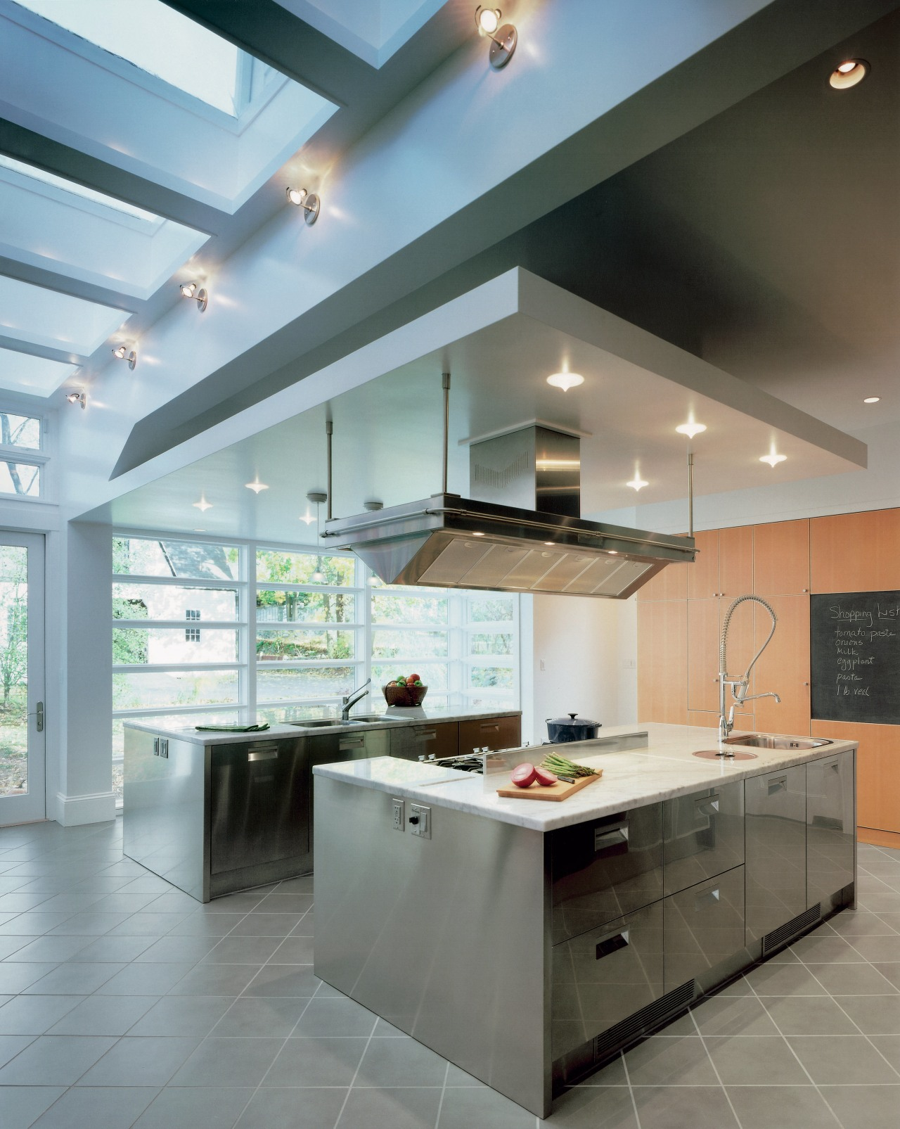 A view of the homes large kitchen area. cabinetry, ceiling, countertop, cuisine classique, daylighting, floor, interior design, interior designer, kitchen, real estate, gray