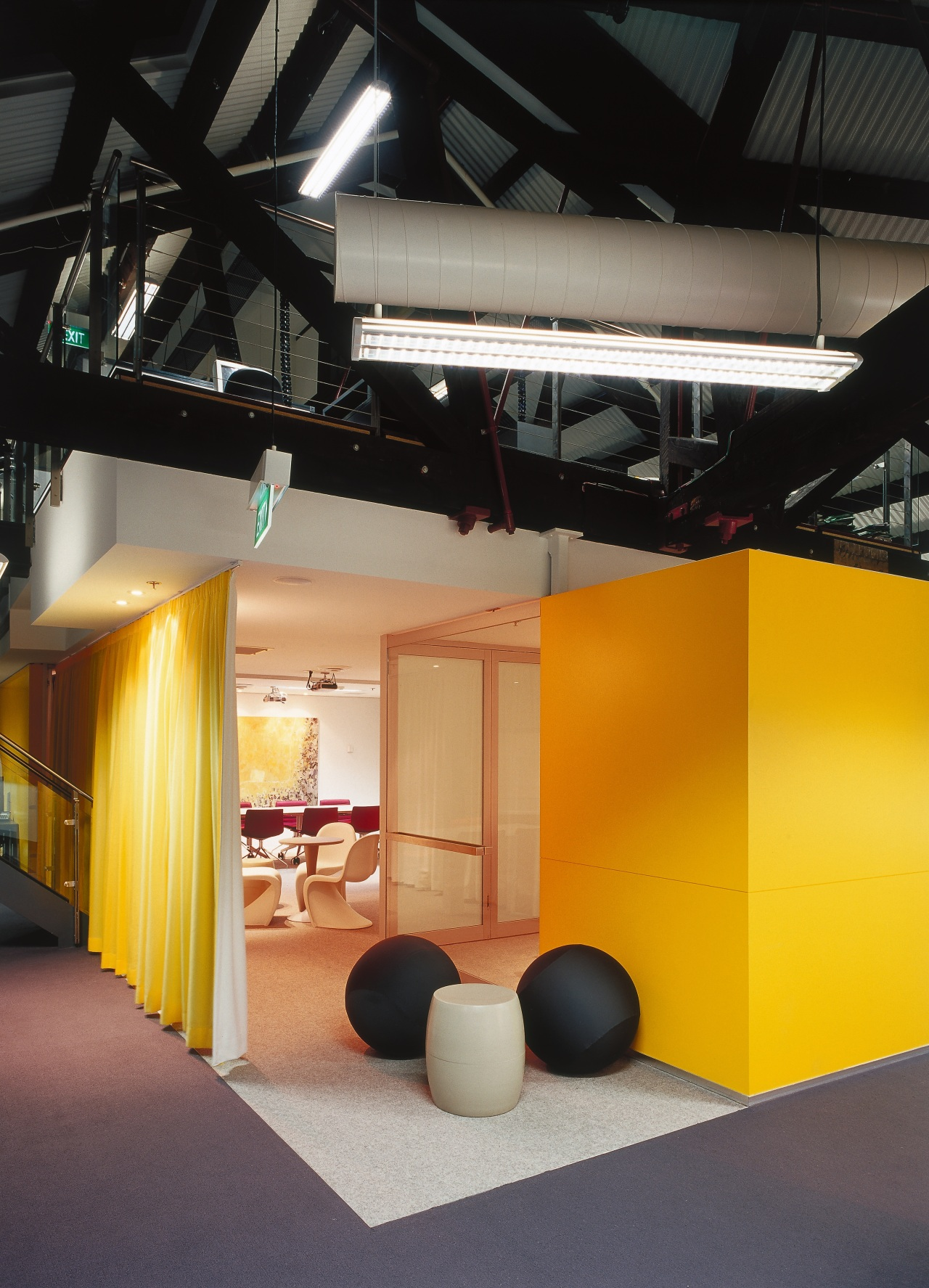 A view of a communal area. architecture, ceiling, interior design, product design, black, orange