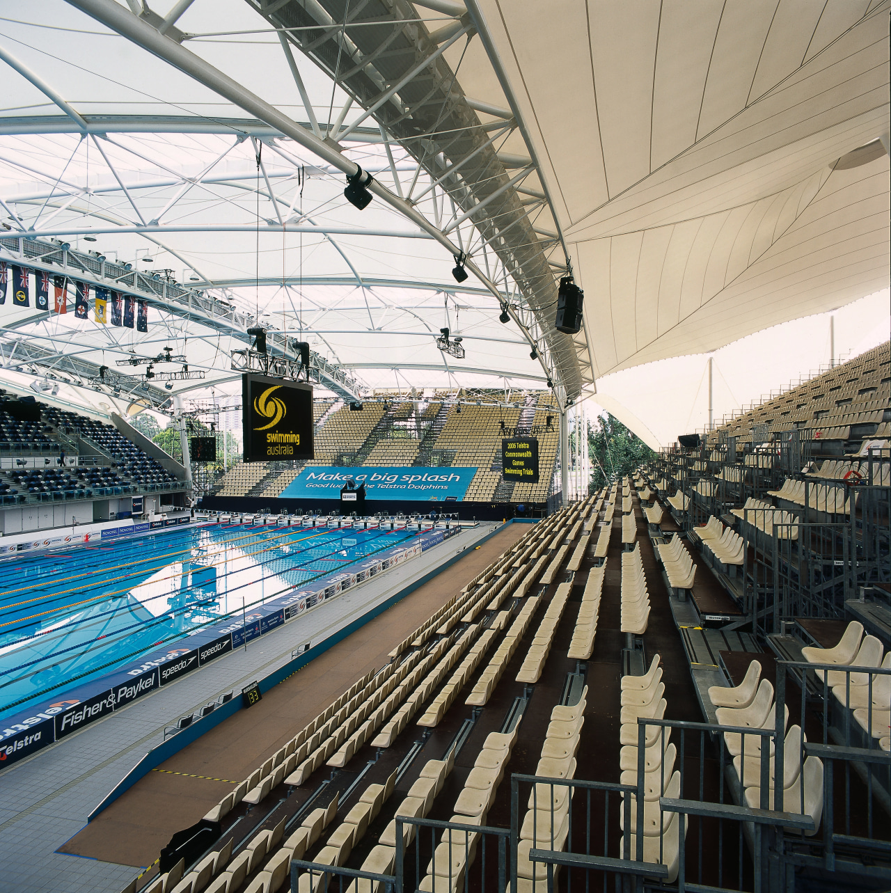 View of competition pool with tiered seating, PTFE arena, roof, sport venue, stadium, structure, white, black