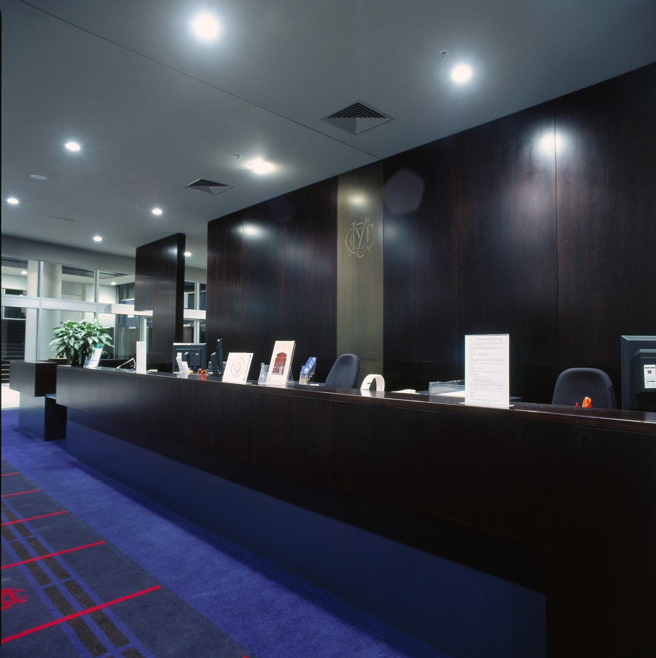 Counter area with timber counter and walll panelling. architecture, ceiling, interior design, lighting, lobby, black, gray