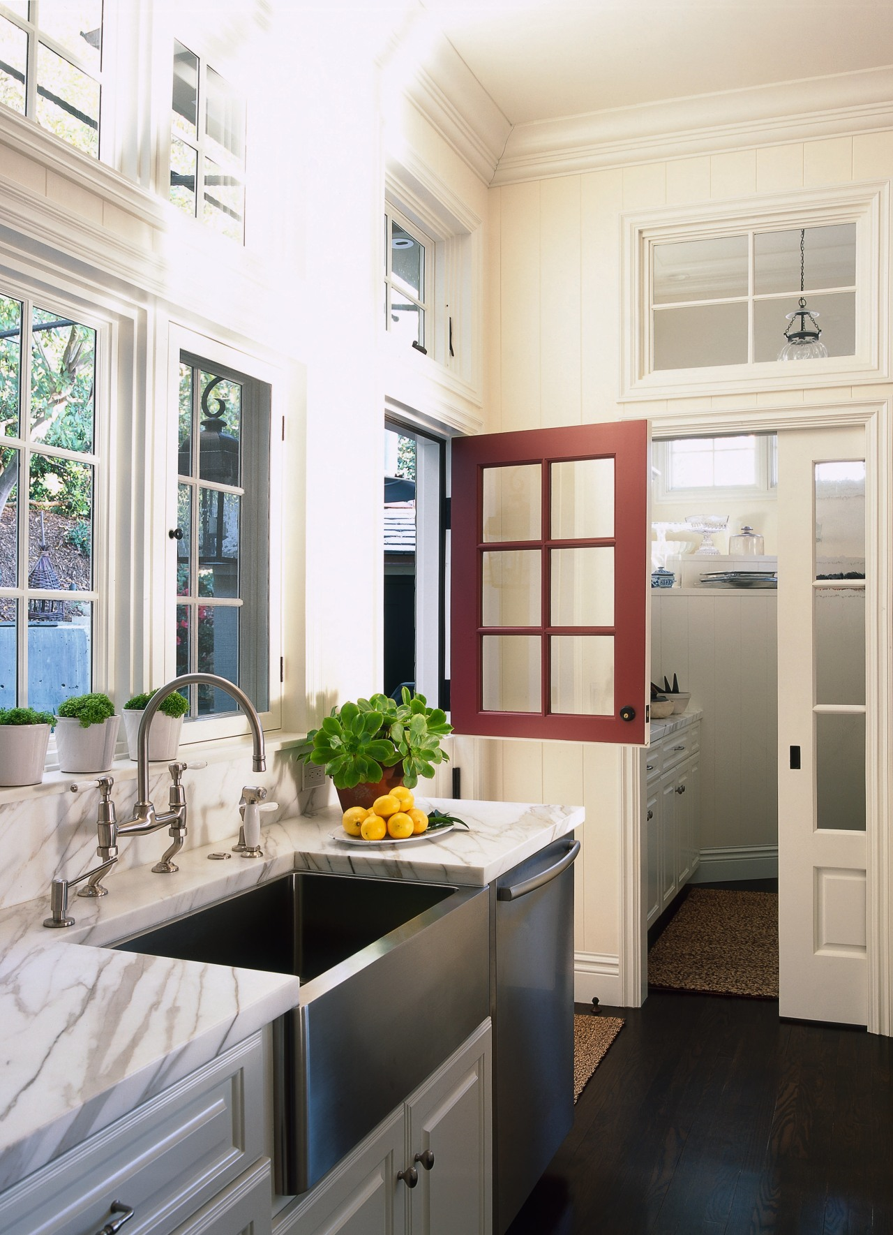 view of this white kitchen featuring white painted cabinetry, countertop, cuisine classique, home, home appliance, interior design, kitchen, window, white