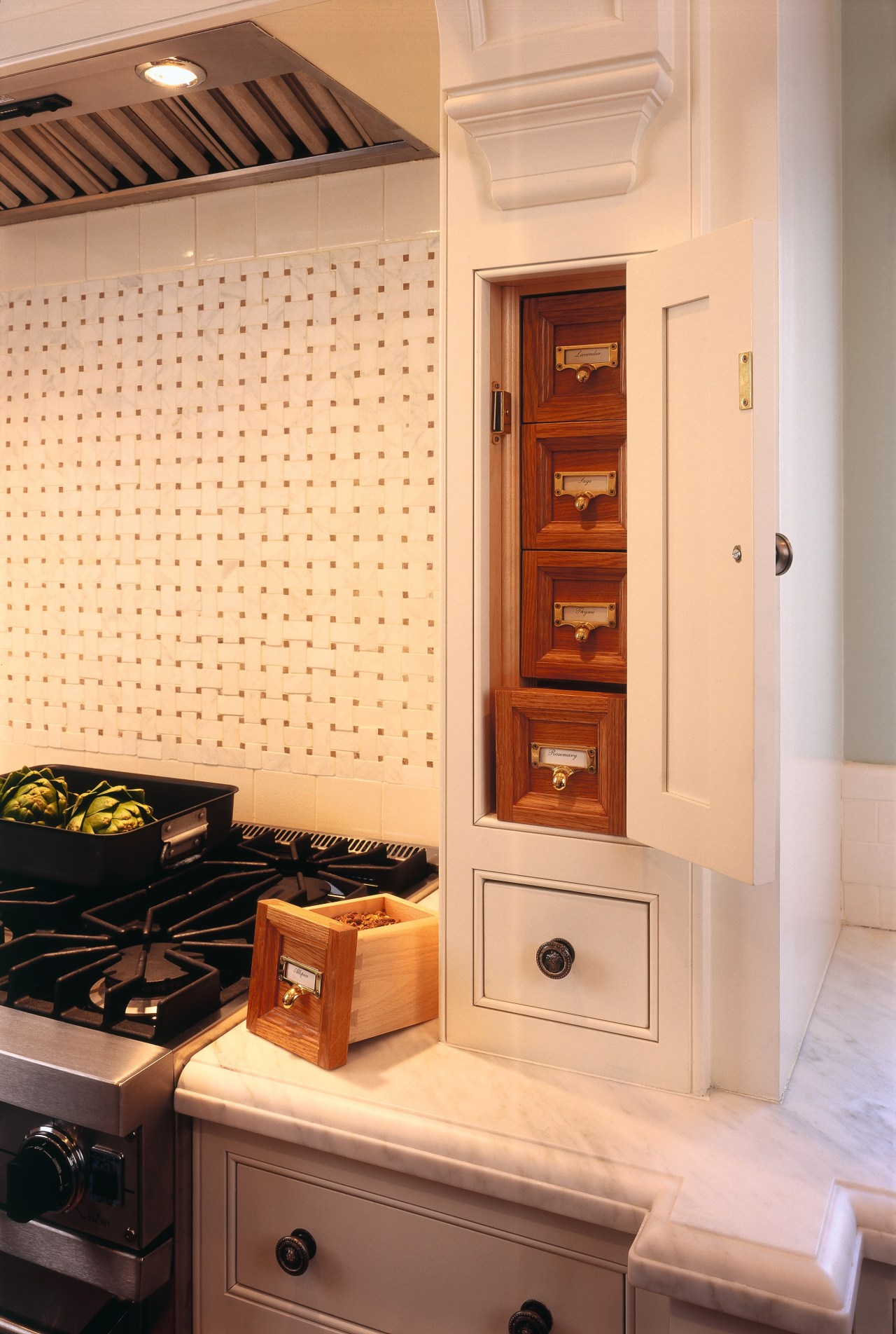 Kitchen with white traditional style cabinetry, spice drawers, cabinetry, countertop, furniture, home appliance, interior design, kitchen, major appliance, room, orange