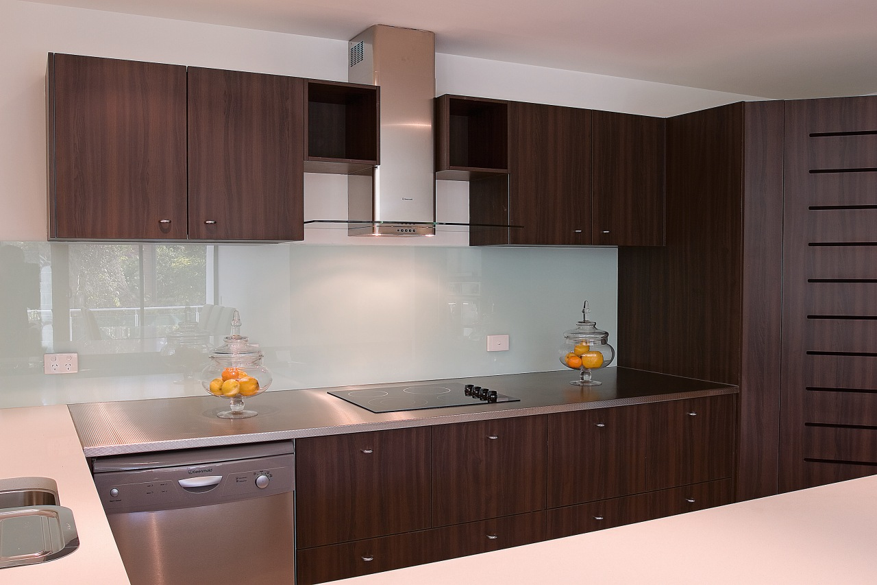 A view of a kitchen with appliances by cabinetry, countertop, cuisine classique, interior design, kitchen, room, gray, red