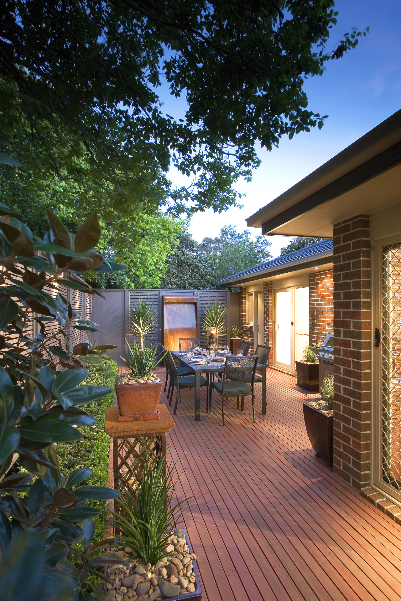 A view of this out door entertainment area backyard, courtyard, deck, estate, home, house, landscaping, outdoor structure, patio, property, real estate, yard